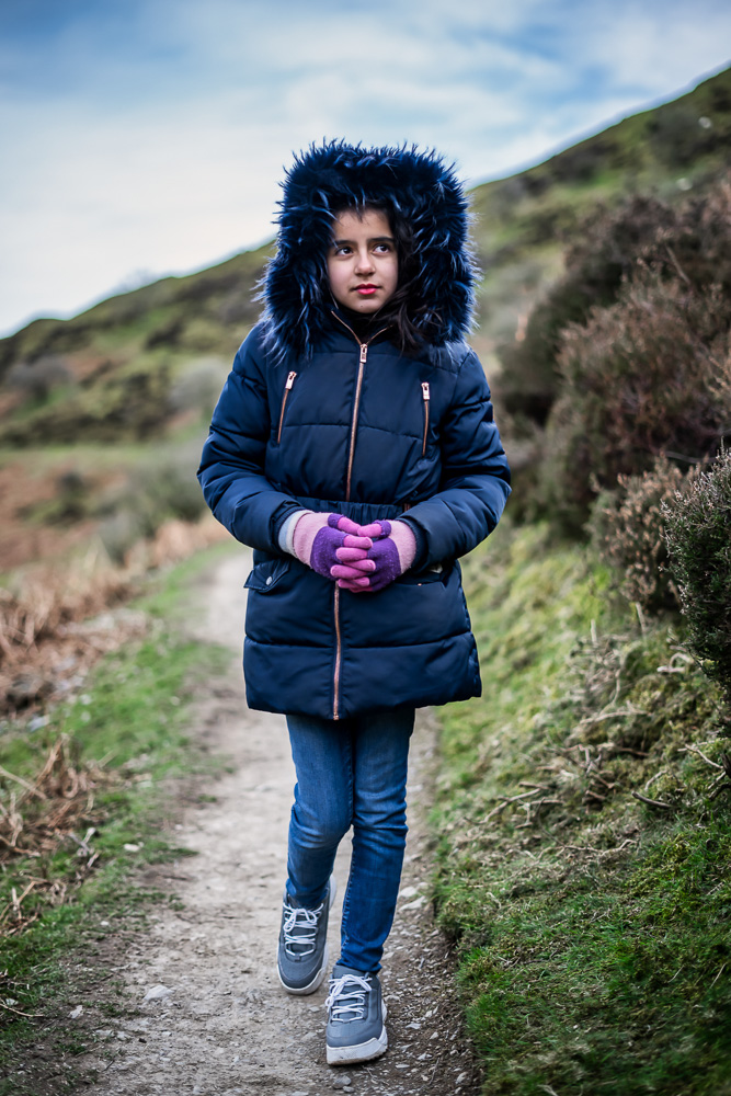 Portrait of girl walking through a narrow path in Carding Mill Valley