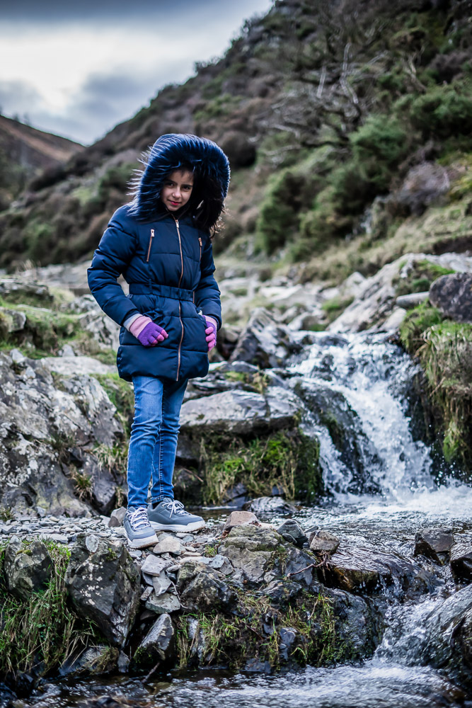 Portrait of a girl by a small waterfall in Carding Mill Valley