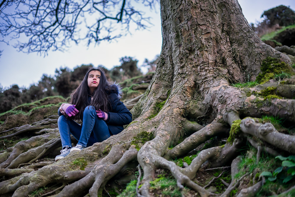 Portrait Pose by tree roots in Carding Mill Valley