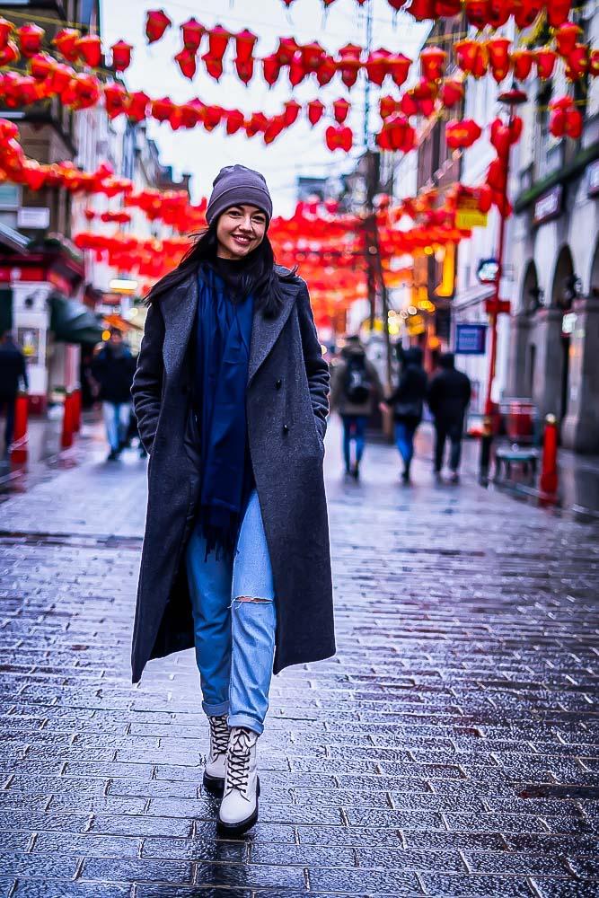 Portait of Girl walking through Gerrard Street, China town, London