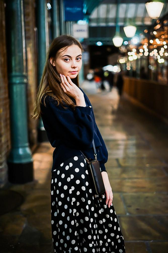 Portait of girl posing in Covent Garden Market, London