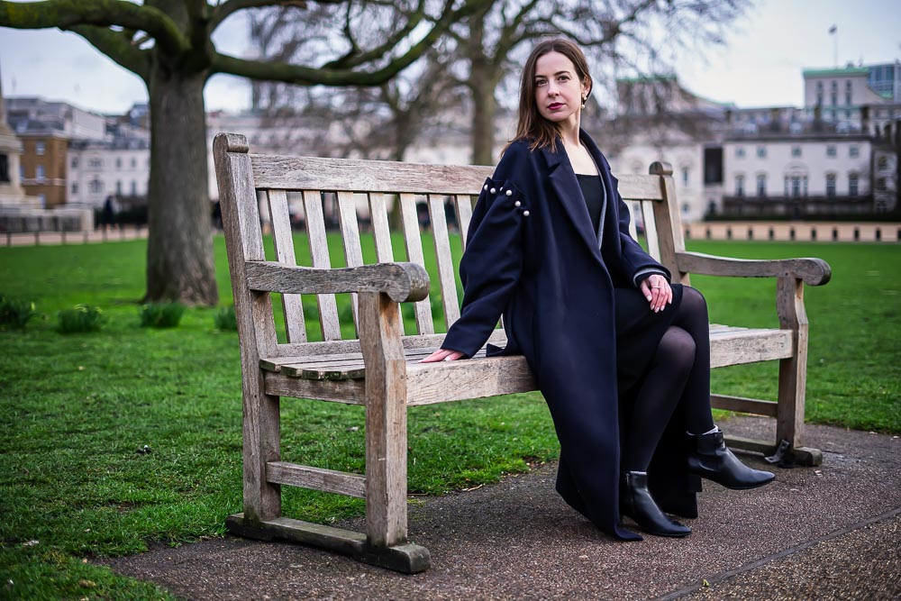 Portrait of a Lady in Mac sat on bench in St James Park, Westminster, London
