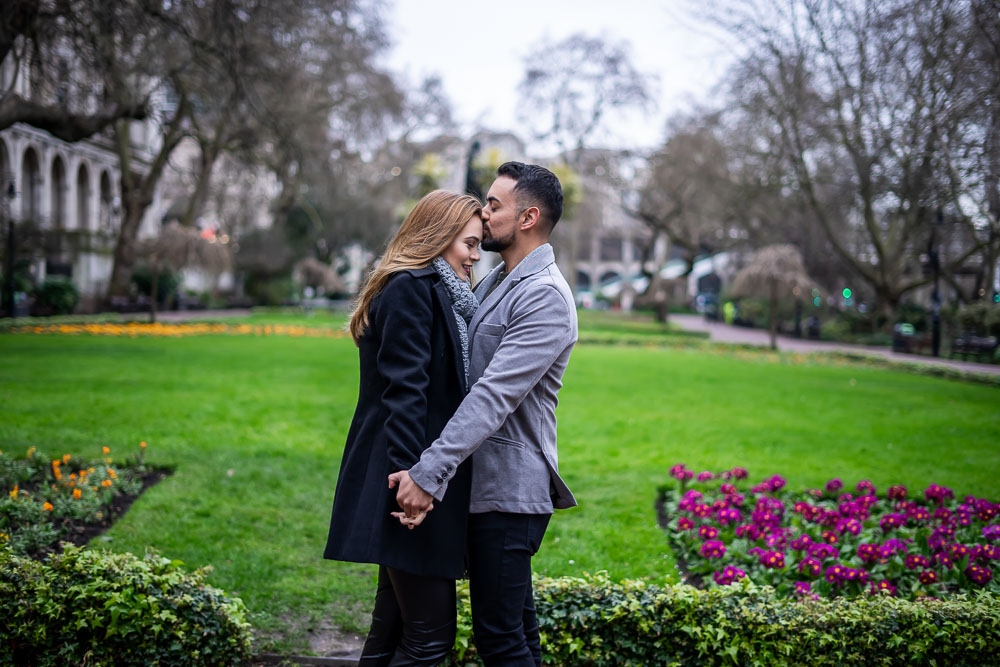 Couple kissing in Whitehall gardens, Westminster, London
