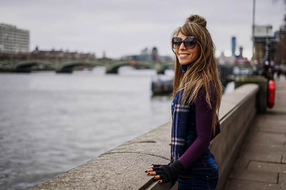 Portrait of girl posing by the river thames, Westminster, London
