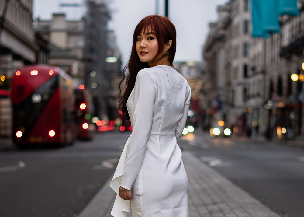 Portrain of girl in white dress on Picadilly, Westminster, London