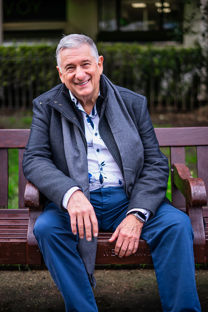 Portrait of Man on park bench in Whitehall gardens wesminster london