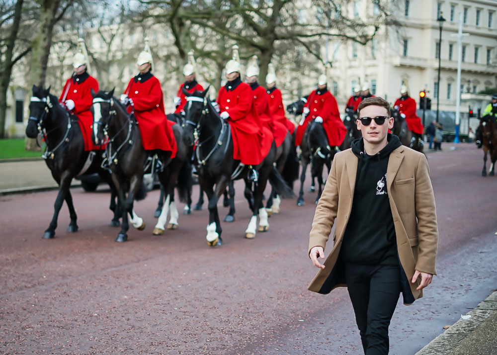 Man walking by the Changing of the Guards, Mall London