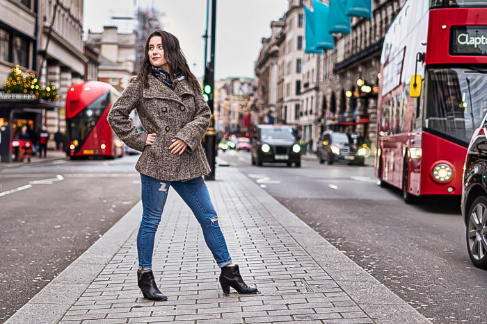 Portrait of woman in picadilly with red London bus