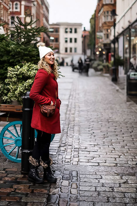 Portrait of Lady in Red Jacket and white hat in Covent Garden, London