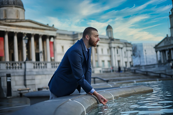 Portrait of man by found fountains in empty trafalgar square